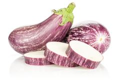 Fresh Raw purple striped Eggplant isolated on white. Two striped purple eggplants with three sliced rings isolated on white background Stock Photos