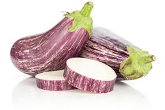 Fresh Raw purple striped Eggplant isolated on white. Two striped purple eggplants with two sliced rings isolated on white background Royalty Free Stock Photography