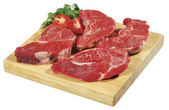 Fresh raw red beef meat big steak chunk on wooden cut board isolated over white background Stock Photo