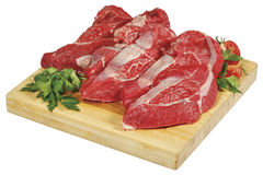 Fresh raw red beef meat big steak chunk on wooden cut board isolated over white background Stock Image