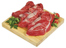 Fresh raw red beef meat big steak chunk on wooden cut board isolated over white background Royalty Free Stock Image