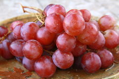 Fresh raw red grape. On wooden table Stock Photography