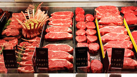 Fresh raw red meat in supermarket. Selection of different cuts of fresh raw red meat in a supermarket Stock Photos