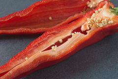Fresh raw red pepper. Fresh raw reed pepper on table Royalty Free Stock Photos