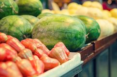 Fresh raw red watermelon display on market stall. Selective focus shot Royalty Free Stock Photos