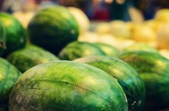 Fresh raw red watermelon on market stall. Selective focus shot Royalty Free Stock Image