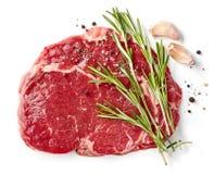 Fresh raw rib eye steak. Isolated on white background, top view Stock Image