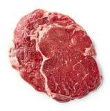 Fresh raw rib eye steak. Isolated on white background, top view Royalty Free Stock Photo