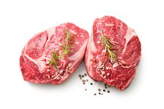 Fresh raw rib eye steaks isolated on white background. Top view royalty free stock images
