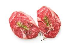 Fresh raw rib eye steaks isolated on white background royalty free stock image