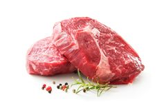 Fresh raw rib eye steaks isolated on white. Background royalty free stock photo