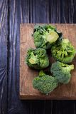 Fresh raw broccoli. Fresh raw ripe broccoli in studio on wooden background Royalty Free Stock Image
