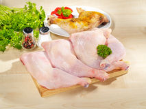 Fresh raw and roasted chicken legs arrangement Royalty Free Stock Photos