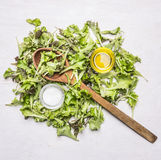 Fresh raw salad with salt oil wooden spoon wooden rustic background top view close up. Fresh raw salad with salt and oil and wooden spoon on wooden rustic Royalty Free Stock Photos