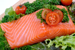 Fresh raw salmon. With vegetables on a white background Stock Photos