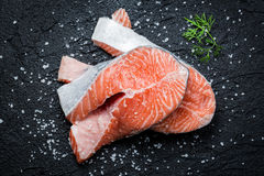 Fresh raw salmon. On black rock Stock Photography