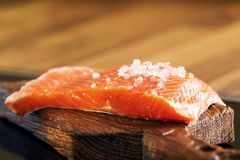 Fresh raw salmon and cooking Ingredients. Top View. Healthy food concept Royalty Free Stock Images