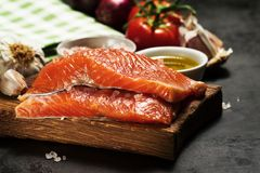 Fresh raw salmon and cooking Ingredients. Top View. Healthy food. Concept Stock Image