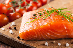 Fresh raw salmon. On cutting board Royalty Free Stock Image