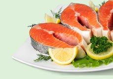 Fresh raw salmon on cutting board. Fresh raw salmon green red closeup market Royalty Free Stock Images