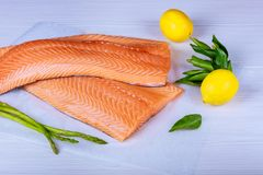 Fresh raw salmon on cutting board and lemon. Raw Salmon Red Fish Fresh raw salmon on cutting board and lemon Stock Images
