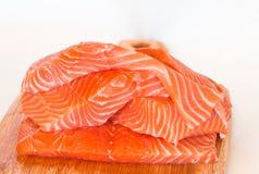 Fresh raw salmon on cutting board. Fresh raw salmon on wooden cutting board Stock Photo