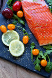 Fresh raw salmon fillet with aromatic herbs and spices. Fresh raw salmon fillet with aromatic herbs, spices Stock Photography