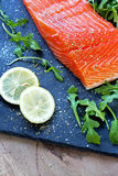 Fresh raw salmon fillet with aromatic herbs and spices. Fresh raw salmon fillet with aromatic herbs, spices Royalty Free Stock Images