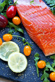 Fresh raw salmon fillet with aromatic herbs and spices. Fresh raw salmon fillet with aromatic herbs, spices Royalty Free Stock Image
