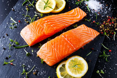 Fresh raw salmon fillet with aromatic herbs, spices. Fresh raw salmon fillet with aromatic herbs, spices on stone background Royalty Free Stock Photos