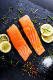 Fresh raw salmon fillet with aromatic herbs, spices. Fresh raw salmon fillet with aromatic herbs, spices on stone background Stock Photo