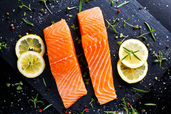 Fresh raw salmon fillet with aromatic herbs, spices. Fresh raw salmon fillet with aromatic herbs, spices on stone background Stock Photography
