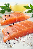 Fresh raw salmon fillet and aromatic spices for baking.  Stock Images