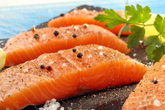 Fresh raw salmon fillet and aromatic spices for baking.  Royalty Free Stock Photo