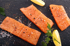 Fresh raw salmon fillet and aromatic spices for baking.  Stock Photo