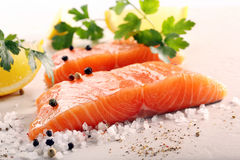 Fresh raw salmon fillet and aromatic spices for baking.  Stock Image