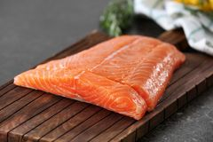 Fresh raw salmon fillet on board. Closeup Stock Photography