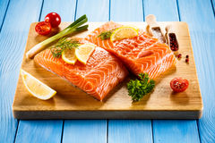 Fresh raw salmon fillet. On cutboard Royalty Free Stock Images