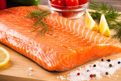 Fresh raw salmon fillet. On cutboard Royalty Free Stock Photos