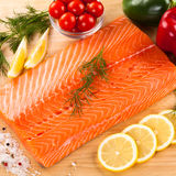 Fresh raw salmon fillet. On cutboard Royalty Free Stock Image