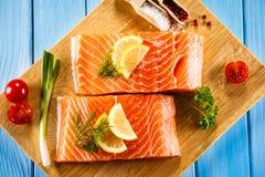 Fresh raw salmon fillet. On cutboard Stock Photos