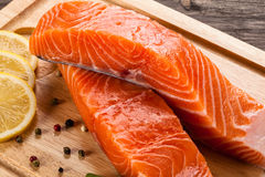 Fresh raw salmon fillet. On cutting board Royalty Free Stock Image