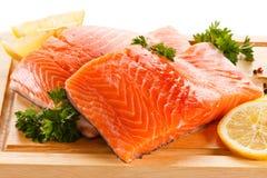 Fresh raw salmon fillet. On cutting board Royalty Free Stock Photo