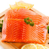 Fresh raw salmon fillet. On cutting board Royalty Free Stock Images