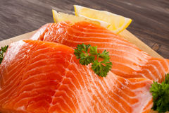 Fresh raw salmon fillet. On cutting board Royalty Free Stock Photos