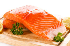Fresh raw salmon fillet. On cutting board Royalty Free Stock Photos