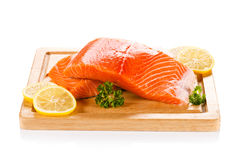 Fresh raw salmon fillet. On cutting board Royalty Free Stock Photo