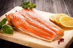 Fresh raw salmon fillet. On cutting board Stock Image