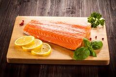 Fresh raw salmon fillet. On cutting board Stock Photo