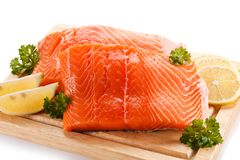 Fresh raw salmon fillet on cutting board. On white background Stock Images